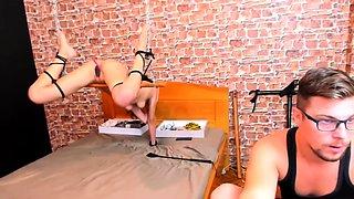Kinky brunette camgirl plays out her bondage fetish fantasy