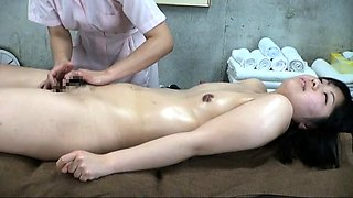 Petite Asian girl surrenders her hairy snatch to a masseuse
