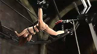Sarah Blake gets fucked by a mighty fucking machine in a cellar