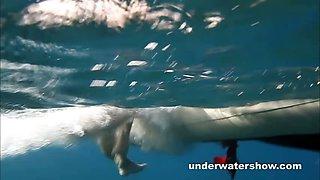 Cute Nastya swimming nude in the sea