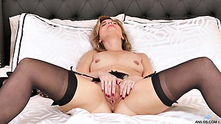 Mature in black stockings shows insolent pussy fingering