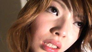 Asian brunette on the toilet wanks on her clit