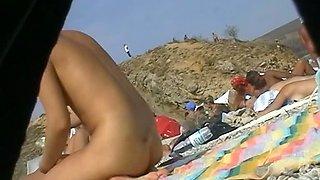 Hidden cam beach catches sexy nudist women sunbathing