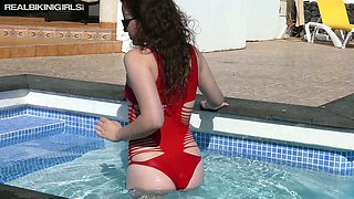 Charming dark haired sweetie Bea Triss poses near the pool