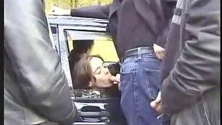Oral loving French whore sucks dicks in public in a car