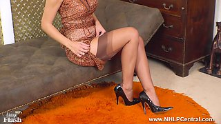 Busty brunette Roxy Mendez strips and wanks off in vintage nylons garter suspenders stilettos