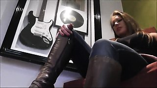 Dominant mature lady has her slave licking her black boots