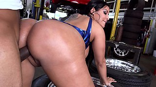 Hot Latina with large tits and a big ass is fucked in a garage