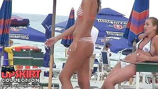 The pretty amateur gadget in the striped sexy bikini is