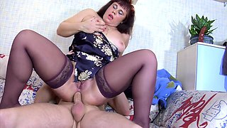 Curvy Russian mom in stockings takes a young dick up her ass