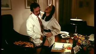 Slutty tall and long legged secretary in black stockings gets nailed in office