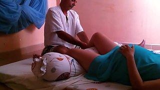 Pregnant woman getting leg massage