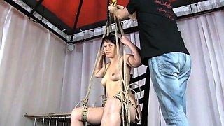 Lovely brunette milf in high heels gets trained in bondage