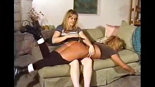 Two ladies indulge in a little gentle spanking. quite a nice bottom though!