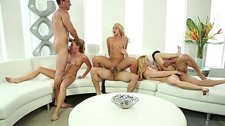 A hot group of swingers is on the sofa, having fun together
