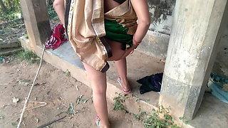 Desi Indian MILF with a big ass milks her own boobs in a farmhouse