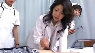 Milf Japan doctor instructs nurses on proper handjob