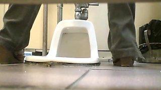 Some nice girls in airport toilet voyeur video