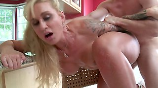 Curvaceous blonde cougar is getting her pussy banged and ass licked