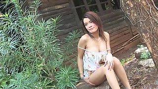 Outdoors video of skinny Thai girl Kwan Galyarut pleasuring her cunt