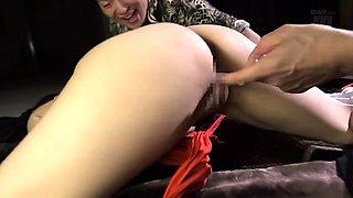 Big breasted Asian chick explores her bondage fetish fantasy