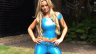 Light haired lady in blue latex clothing is ready for some horny solo