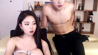 Korean beauty in pantyhose plays with her man