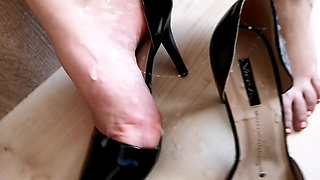 Wife in home office with black heels